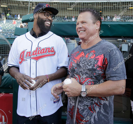 """Baron Davis, Jerry """"The King"""" Lawler Cleveland Cavaliers Baron Davis, left, shares a laugh with WWE wrestling star Jerry """"The King"""" Lawler on the field for pregame activities before a baseball game between the Cleveland Indians and the Texas Rangers in Cleveland on"""