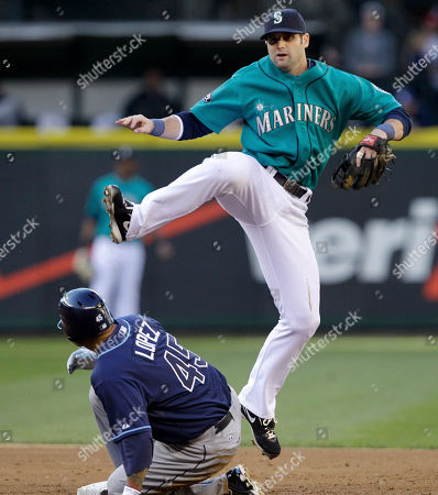 Felipe Lopez, Adam Kennedy Seattle Mariners second baseman Adam Kennedy, right, leaps out of the way after forcing out Tampa Bay Rays' Felipe Lopez at second base and completing a double play in the third inning of a baseball game, in Seattle