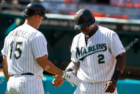 Hanley Ramirez, Gaby Sanchez Florida Marlins' Hanley Ramirez (2) is met by Gaby Sanchez (15) after scoring on a double hit by Logan Morrison during an interleague baseball game against the Tampa Bay Rays in Miami
