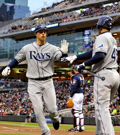 Ben Zobrist, Sean Rodriguez Tampa Bay Rays' Ben Zobrist, left, is greeted by Felipe Lopez after scoring on a Sean Rodriguez single off Minnesota Twins' Francisco Liriano in the first inning of a baseball game, in Minneapolis. Zobrist hit a two-run triple in the inning