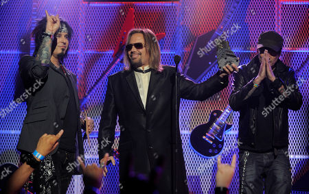 Stock Image of Nikki Sixx, Vince Neil, Tommy Lee From left, Nikki Sixx, Vince Neil and Tommy Lee of Motley Crue accept the Ronnie James Dio Lifetime Achievement Award during the 3rd Annual Revolver Golden Gods Awards, in Los Angeles