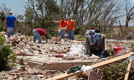 Deborah Fields Deborah Fields, center, a family member of three-year-old Ryan Hamill, who, until his body was discovered today, had been missing since a deadly tornado outbreak on Tuesday, cleans up debris from what little remains of the Hamil home, the house Ryan was in when the tornado hit, in Piedmont, Okla