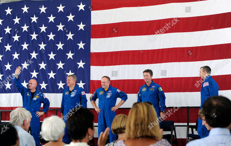 Mark Kelly, Greg Johnson, Mike Finke, Drew Feustel, Roberto Vittori Space shuttle Endeavour crew members from left: commander Mark Kelly, pilot Greg Johnson, mission specialists Mike Finke, European Space Agency astronaut Roberto Vittori of Italy and Drew Feustel take the stage during a welcome home from space ceremony, at a NASA hangar in Houston