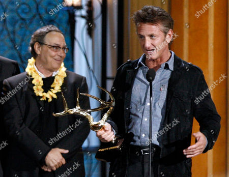 "Sean Penn, Robert Romanus Sean Penn, right, accepts the award for guy movie hall of fame for ""Fast Times at Ridgemont High"" as Robert Romanus looks on at the Spike TV Guys Choice Awards, in Culver City, Calif"