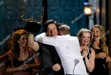 "Mark Wahlberg,Dicky Eklund Mark Wahlberg, left, is embraced by former professional boxer Dicky Eklund as he accepts the guy movie of the year award for ""The Fighter"" at the Spike TV Guys Choice Awards, in Culver City, Calif"