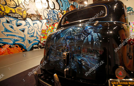 """Mister Cartoon's Midnight Express,"""" on a 1939 Chevrolet Master Deluxe, by the artist known as Mister Cartoon, is seen at Art In The Streets, an exhibition of street art at the Museum of Contemporary Art in the Little Tokyo district of downtown Los Angeles"""