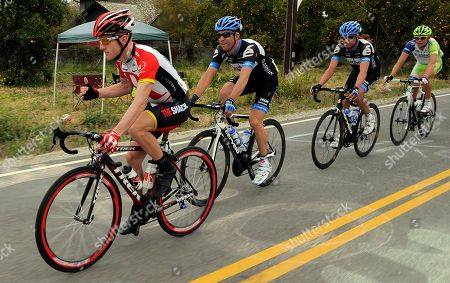 Levi Leipheimer, Christian Vandevelde Levi Leipheimer, left, talks with Christian Vandevelde, second from left, during the final stage of the Tour of California cycling race, near Piru, Calif