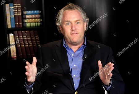 """Andrew Breitbart Conservative activist Andrew Breitbart, who runs the websites BigGovernment.com and BigJournalism.com, gestures as he speaks during an interview at the Associated Press in New York, about Congressman Anthony Weiner, who Monday confessed to conducting """"inappropriate"""" online exchanges with six women. Breitbart claims he is holding onto at least one more unreleased Twitter photo of Congressman Weiner"""