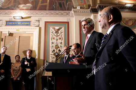 Stock Photo of John Kerry, Mahmoud Jibril, Ali Suleiman Aujali, Abdurrahman Mohamed Shalgham Senate Foreign Relations Committee Chairman Sen. John Kerry, D-Mass., talks about his meeting with a Libyan delegation opposed to the regime of Moammar Gadhafi, on Capitol Hill in Washington. From left to right at the lectern are: Ali Suleiman Aujali, the former Libyan ambassador to the U.S. who publicly broke with Moammar Gadhafi's regime in February, Mahmoud Jibril, representative for foreign affairs with the Libyan Transitional National Council, Kerry, and former Libyan ambassador to the United Nations Abdurrahman Mohamed Shalgham
