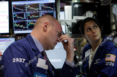 Stock Picture of Evan Solomon, Jennifer Klesaris Specialists Evan Solomon and Jennifer Klesaris work n the floor of the New York Stock Exchange . Fears that the economy is stalling sent the Dow Jones industrial average down 280 points, erasing more than a quarter of the stock market's gains for the year