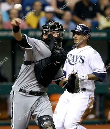A.J. Pierzynski, Felipe Lopez Chicago White Sox catcher A.J. Pierzynski, left, forces Tampa Bay Rays' Felipe Lopez out at home and relays the throw to first base to throw out Rays' John Jaso on a second inning double play during an MLB baseball game, in St. Petersburg, Fla