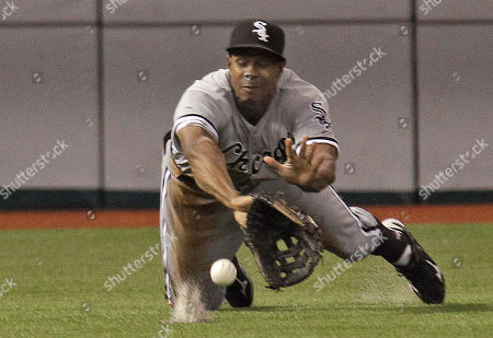 Juan Pierre Chicago White Sox left fielder Juan Pierre dives but cannot come up with a second-inning single by Tampa Bay Rays' Felipe Lopez during an MLB baseball game on in St. Petersburg, Fla