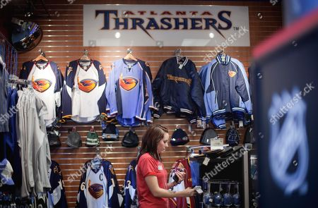 Emily Kennedy Atlanta Thrashers fan Emily Kennedy, of Atlanta, shops at the team store inside Philips Arena, in Atlanta. Atlanta has become the first city in the NHL's modern era to lose two hockey teams as the Thrashers' owners agreed Tuesday to sell the struggling franchise to a group that will move it to Winnipeg next season. The Flames moved to Calgary in 1980 after eight seasons in Atlanta
