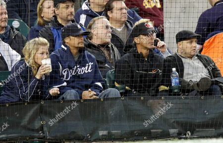 Kid Rock, Chris Chelios Kid Rock, in Detroit jacket, and Chris Chelios, right, watch the baseball game between the Detroit Tigers and the New York Yankees, in Detroit