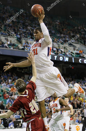 Devin Booker, John Cahill Clemson's Devin Booker (31) towers over Boston College's John Cahill (20) in the second half of an NCAA college basketball game at the Atlantic Coast Conference tournament in Greensboro, N.C