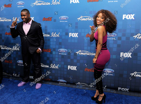 "Jacob Lusk, Ashthon Jones American Idol"" finalists Jacob Lusk, left, and Ashthon Jones pose for photographers at the ""American Idol"" Finalists Party in Los Angeles"