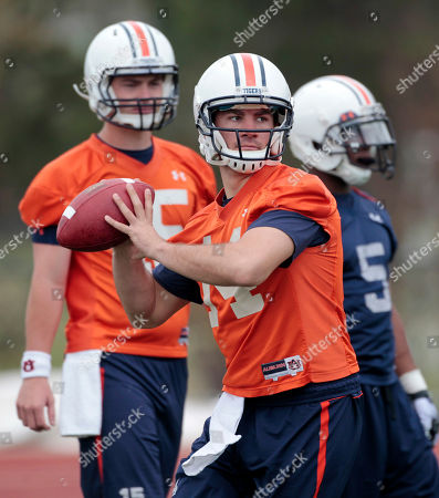 Barrett Trotter, Clint Moseley, Michael Dyer Auburn quarterback Barrett Trotter (14) throws during the first day of spring NCAA college football practice for the national champion Auburn Tigers in Auburn, Ala., . At rear is quarterback Clint Moseley (15) and running back Michael Dyer (5