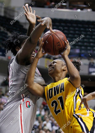 Kachine Alexander, Jantel Lavender Iowa guard Kachine Alexander, right, crashes into Ohio State center Jantel Lavender as she drives the lane in the first half of an NCAA college basketball game in the Big Ten tournament in Indianapolis, . AP Photo/Michael Conroy