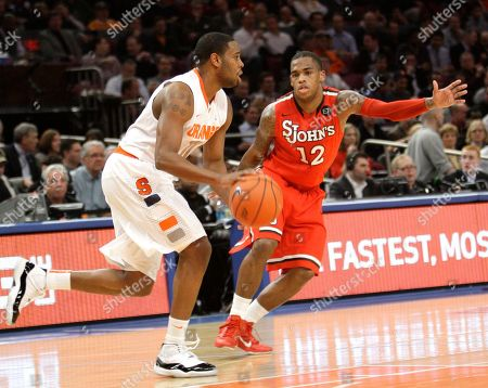 Scoop Jardine, Dwight Hardy Syracuse's Scoop Jardine drives past St. John's Dwight Hardy during the first half of an NCAA college basketball game at the Big East Championship, at Madison Square Garden in New York