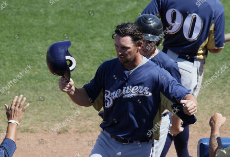 Jeremy Reed Milwaukee Brewers' Jeremy Reed celebrates with teammates after scoring a single hit by Edwin Maysonet during the sixth inning of a spring training baseball game against the San Diego Padres, in Peoria, Ariz