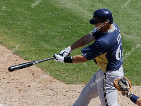 Jeremy Reed Milwaukee Brewers' Jeremy Reed hits an one-run double against the San Diego Padres during the sixth inning of a spring training baseball game, in Peoria, Ariz
