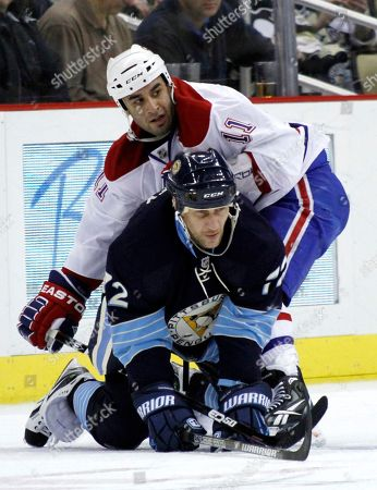 Scott Gomez, Alexei Kovalev Montreal Canadiens' Scott Gomez (11) holds Pittsburgh Penguins' Alexei Kovalev (72) on the ice as they play in the NHL hockey game between the Pittsburgh Penguins and the Montreal Canadiens, in Pittsburgh
