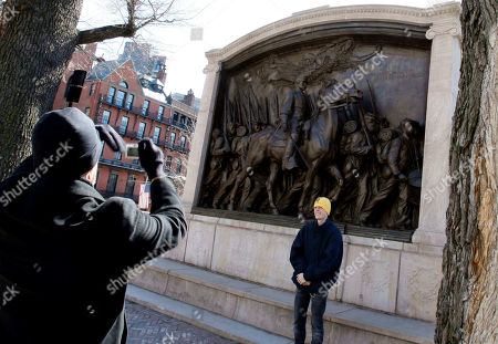 People take a photograph in front of the memorial to Union Col. Robert Gould Shaw and the 54th Massachusetts Volunteer Infantry Regiment, near the Statehouse in Boston. The 54th was the first regiment composed of men of African decent recruited in the North for battle in the Civil War