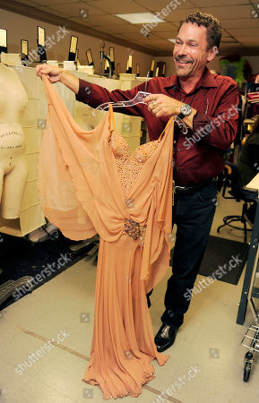 """Stock Image of Randall Christensen Randall Christensen, costume designer for the show """"Dancing with the Stars,"""" shows off an outfit for dancer Cheryl Burke backstage at the show's offices in Los Angeles"""