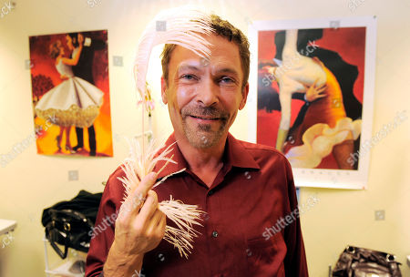 """Randall Christensen Randall Christensen, costume designer for the show """"Dancing with the Stars,"""" poses with a feather used as a costume detail backstage at the show's offices in Los Angeles"""