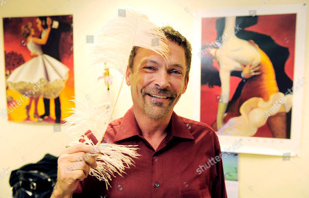 """Randall Christensen Randall Christensen, the costume designer for """"Dancing with the Stars,"""" poses with a feather used as a detail in costumes for the show, backstage at the show's offices in Los Angeles"""