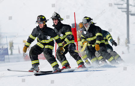 Erik Knudsen, Neils Knudsen, J.D. LLoyd, Doug Patey Erik Knudsen, leads teammates Neils Knudsen, (12) J.D. LLoyd, (13) and Doug Patey of the Falmouth, Maine fire dept., as they compete in the 21st Annual Firefighter's Fundraising Race, at the Sunday River ski resort in Newry, Maine. Teams of five wearing firefighting gear carried a 50-foot hose while negotiating a giant slalom race course. The race benefits the Maine Handicapped Skiing program