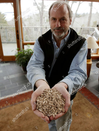 Tom Wright Tom Wright holds a handful of wood pellets which he uses to heat his home in Freeport, Maine. Wright uses about nine tons of pellets to heat his home and office