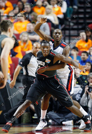 Rakeem Christmas, Bismack Biyombo The U.S. Junior National Team's Rakeem Christmas, right, of Philadelphia, Pa., defends against the World Team's Bismack Biyombo, left, of Congo, in the first half during the Nike Hoop Summit basketball game, in Portland, Ore