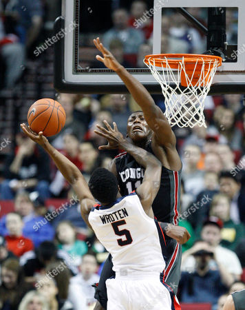 Tony Wroten, Bismack Biyombo The U.S. Junior National Team's Tony Wroten, of Seattle, Wash., shoots as the World Team's Bismack Biyombo, of Congo, defends in the first half during the Nike Hoop Summit basketball game, in Portland, Ore