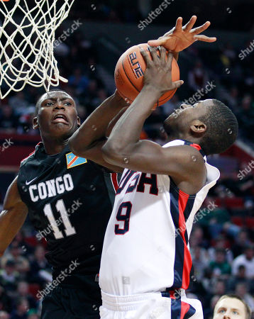 Bismack Biyombo, Michael Gilchrist The World Team's Bismack Biyombo (11), of Congo, blocks the shoot of the U.S. Junior National Team's Michael Gilchrist (9), of Somerdale, N.J., in the second half during the Nike Hoop Summit basketball game, in Portland, Ore. The U.S. Junior National Team defeated the World Team 92-80