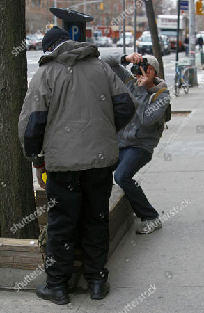 """Brandon Stanton Photographer Brandon Stanton, right, photographs a man on a New York City sidewalk while working his project entitled """"Humans of New York."""" Stanton's photos go on his website, at humansofnewyork.com, and are linked to the neighborhoods in which they were taken"""