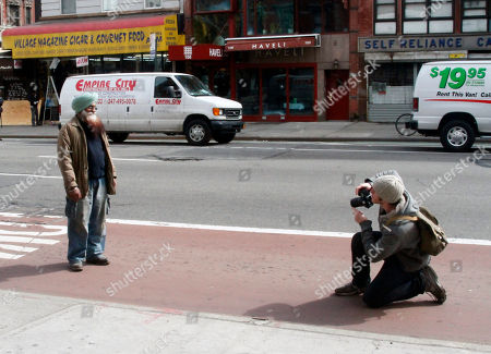 """Brandon Stanton Photographer Brandon Stanton, right, prepares to photograph a man on a New York City street for his project entitled """"Humans of New York."""" The photos go on his website, at humansofnewyork.com, and are linked to the neighborhoods in which they were taken"""