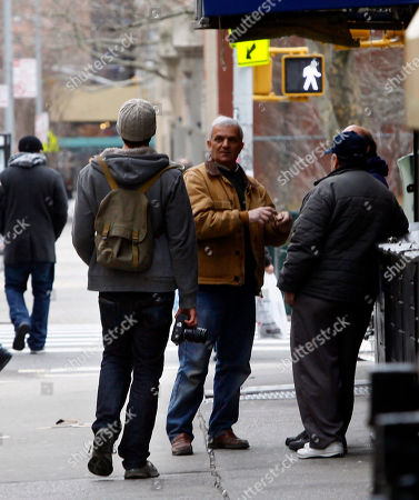 """Brandon Stanton Photographer Brandon Stanton, right, speaks to a couple men on a New York City sidewalk as he works the streets of New York City to make photos of people he finds interesting for his project entitled """"Humans of New York."""" The photos go on his website, at humansofnewyork.com, and are linked to the neighborhoods in which they were taken"""