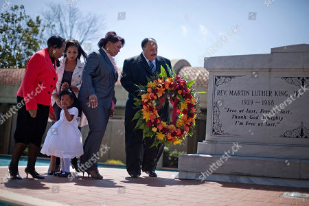 Christine King Farris, Rev. Bernice King, Martin Luther King III, Arndrea King, Yolanda King Martin Luther King III, right, the son of Dr. Martin Luther King Jr., lays a wreath at the crypt of his father along with from right, Dr. King's daughter, Rev. Bernice King, granddaughter Yolanda, 2, her mother Arndrea King, and Christine King Farris, sister of Dr. King Jr., on the 43rd anniversary of his assassination, in Atlanta. The eldest son of the Rev. Martin Luther King Jr. is calling attention to workers' rights as the civil rights icon's family mourns the 43rd anniversary of his slaying