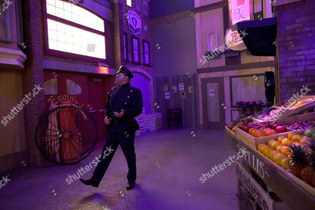 An actor playing a beat cop walks through a set at the Mob Experience at the Tropicana, in Las Vegas. The Mob Experience which opens Wednesday on the Las Vegas Strip, is an interactive attraction featuring gangster memorabilia and commentary from film mobsters James Caan, Mickey Rourke and Frank Vincent. Speakeasies, bootleggers, gun-wielding crime lords, easy women and gruff Italian accents pay homage to Las Vegas' mob roots in a pair of new attractions glamorizing Sin City's criminal history