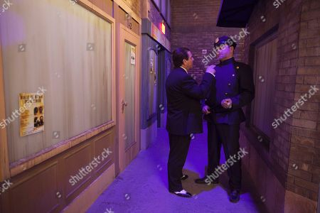 Actors playing a beat cop and a mobster act out a scene at the Mob Experience at the Tropicana Hotel and Casino, in Las Vegas. The Mob Experience which opens Wednesday on the Las Vegas Strip, is an interactive attraction featuring gangster memorabilia and commentary from film mobsters James Caan, Mickey Rourke and Frank Vincent. Speakeasies, bootleggers, gun-wielding crime lords, easy women and gruff Italian accents pay homage to Las Vegas' mob roots in a pair of new attractions glamorizing Sin City's criminal history