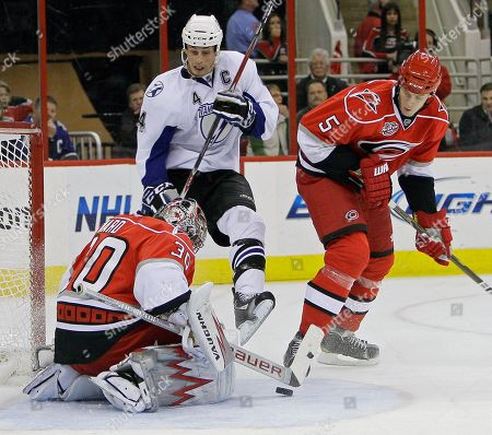 Cam Ward, Bryan Allen, Vincent Lecavalier Carolina Hurricanes goalie Cam Ward (30) defends the goal with Bryan Allen (5) as Tampa Bay Lightning's Vincent Lecavalier (4) looks for a shot on goal during the second period of an NHL hockey game in Raleigh, N.C