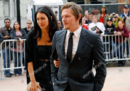 """Norman Reedus, Glenn Lovrich Actor Norman Reedus, right, with Glenn Lovrich arrives at Ford's Theatre for The American Film Company's premiere of Robert Redford's film """"The Conspirator"""" in Washington"""