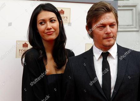 """Stock Image of Norman Reedus, Glenn Lovrich Actor Norman Reedus, right, with Glenn Lovrich arrives at Ford's Theatre for The American Film Company's premiere of Robert Redford's film """"The Conspirator"""" in Washington"""