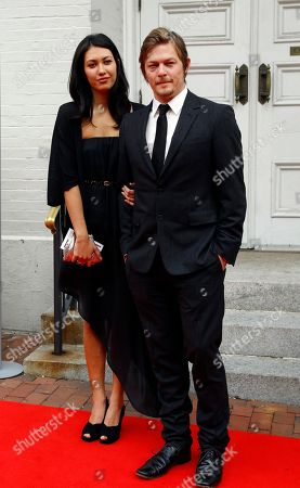 """Stock Picture of Norman Reedus, Glenn Lovrich Actor Norman Reedus, right, with Glenn Lovrich arrives at Ford's Theatre for The American Film Company's premiere of Robert Redford's film """"The Conspirator"""" in Washington"""