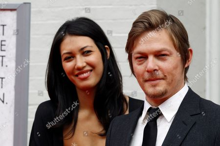 """Stock Photo of Norman Reedus, Glenn Lovrich Actor Norman Reedus, right, with Glenn Lovrich arrives at Ford's Theatre for The American Film Company's premiere of Robert Redford's film """"The Conspirator"""" in Washington"""