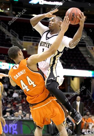 Demetrius Ward, Anthony Henderson Western Michigan's Demetrius Ward (1) drives up and over Bowling Green's Mike Dabney (44) in the second half of an NCAA college basketball game in the quarterfinals of the Mid-American Conference tournament . Western Michigan won the game 67-56