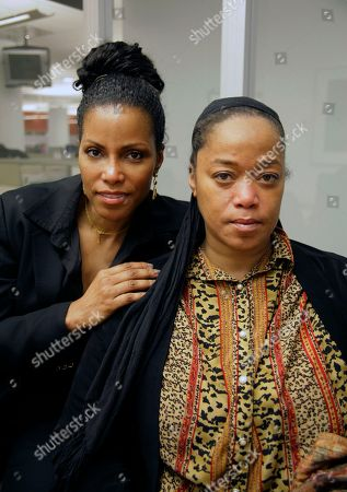 """Ilyasah Shabazz, left, and Malaak Shabazz, daughters of slain civil rights leader Malcolm X, are shown on in New York. The Shabazz sisters are unhappy about a new biography, """"A Life of Reinvention: Malcolm X,"""" which alleges that their parents' marriage was strained and that their mother, Betty Shabazz, was unfaithful"""