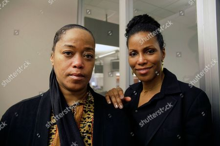 """Ilyasah Shabazz, right, and Malaak Shabazz, daughters of slain civil rights leader Malcolm X, are shown on in New York. The Shabazz sisters are unhappy about a new biography, """"A Life of Reinvention: Malcolm X,"""" which alleges that their parents' marriage was strained and that their mother, Betty Shabazz, was unfaithful"""