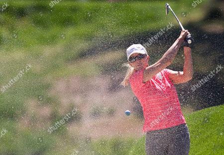 Stock Picture of Janet Gretzky Janet Gretzky, Wayne Gretzky's wife, hits out of a bunker on the ninth fairway while playing in the Michael Jordan Invitational celebrity golf tournament, in Las Vegas